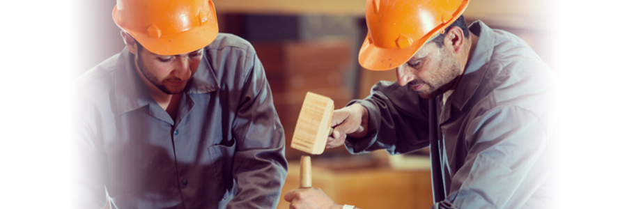 Two men in orange hardhats working